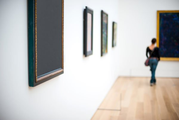 Art gallery with blurred lady in the background